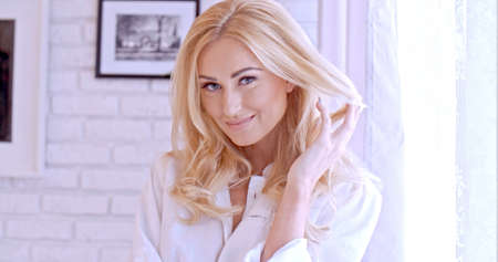 smirk: Gorgeous Blond Woman Looking at the Camera