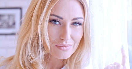 smirk: Close up Pretty Blond Woman Face