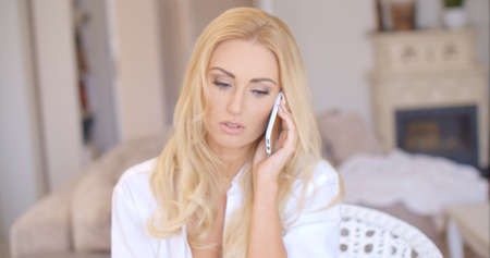 demure: Close up Blond Woman Calling Through Phone