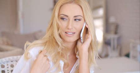 bad hair day: Smiling Blond Female Talking through Phone