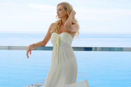 balcony: Blond Woman Standing on Ocean View Balcony
