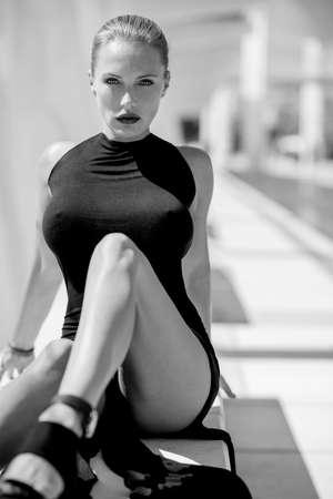 Elegant Sexy Woman Posing in Black Dress at Malaga Harbour Stock Photo