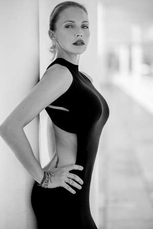 sexy dress: Elegant Sexy Woman Posing in Black Dress at Malaga Harbour Stock Photo