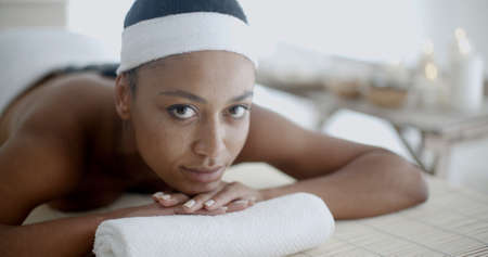 hot stone: Young woman getting hot stone massage in spa salon