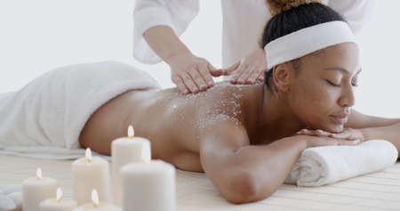 revitalize: Close-up of a beautiful black woman getting spa treatment