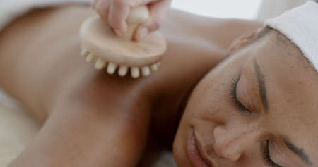 slow motion: Close up of a woman enjoying a back massage at the health spa slow motion