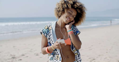 slow motion: Close-up portrait of young happy woman talking on mobile phone on the beach in slow motion,
