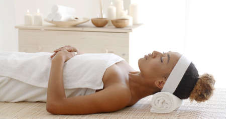 slow motion: Beautiful african american woman in spa center slow motion Stock Photo
