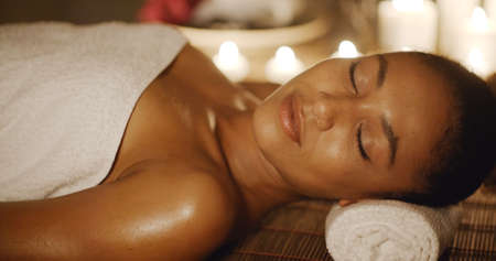 natural face: Close up of a smiling woman relaxing on a lounger in a wellness center