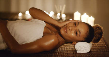 slow motion: Cute african american woman relaxing in spa slow motion Stock Photo