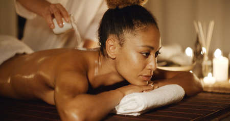 slow motion: Body massage with marine salt in a spa in slow motion