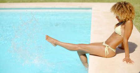 slow motion: Slow Motion Video of Girl in Bikini Swimsuit Relaxing in Swimming Pool
