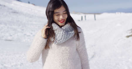 sweater girl: Smiling asian girl in woolen sweater relaxing Stock Photo