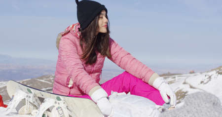 sierra: Woman with snowboard relaxing on mountain