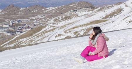sierra nevada: Young woman on snowy mountain summit
