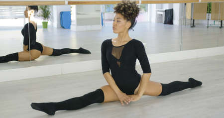 sexy young girls: Supple young dancer doing the splits