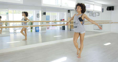 people in action: Modern female dancer in bright studio practicing Stock Photo