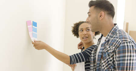 dilema: Young couple trying to choose a paint color Stock Photo
