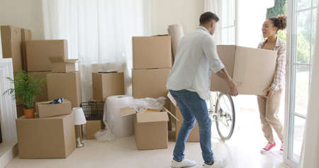 boy lady: Happy young couple moving into a new house Stock Photo