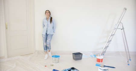 Young woman visualising redecorating her home