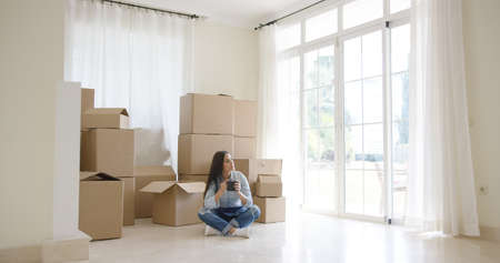 home life: Young woman starting a new life in a new home