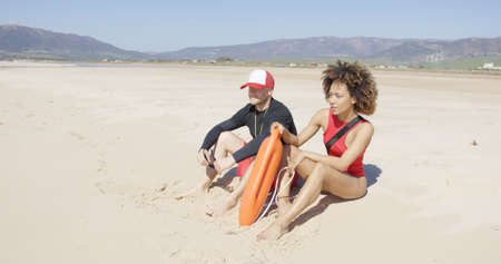 patrolling: Female and male lifeguards patrolling beach
