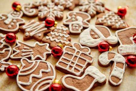 Christmas cookies compostion on table. With small balls. Various shapes on gingerbread biscuits. View from above. Imagens