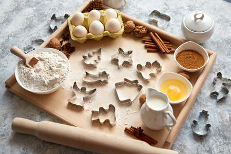 Delicious fresh and healthy ingredients for Christmas gingerbread. Placed on a wooden pastry board. View from above.