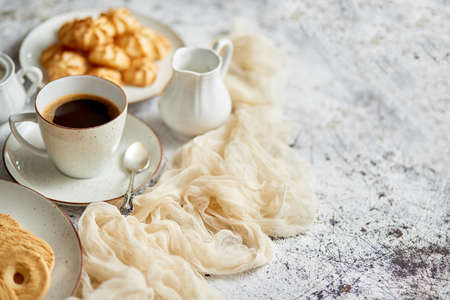 Side view of delicious dessert served. Butter and coconut cookies with cup of black coffee