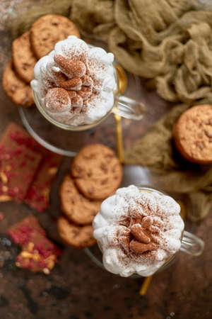 Sweet dessert served. Hot chocolate with whipped cream on top and cookies