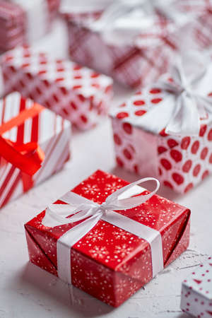 Christmas concept. Close up on festive paper wrapped gifts with ribbon Banco de Imagens