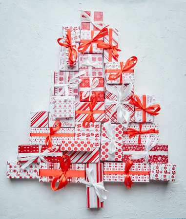 Colorful Christmas tree formed from different various pattern and size boxed gifts Banco de Imagens