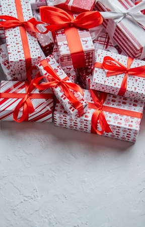 A pile various size wrapped in festive paper boxed gifts placed on stack. Christmas concept Banco de Imagens