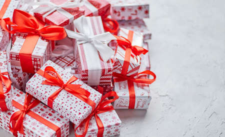 Various pattern and size Christmas boxes placed on white background. Wrapped in festive paper Banco de Imagens