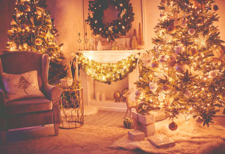 Christmas interior concept. With fireplace, armchair, pine tree, wrapped gifts, lights Banco de Imagens