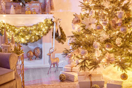 Beautiful Christmas interior decoration for family celebration with pine tree, armchair, fireplace Banco de Imagens
