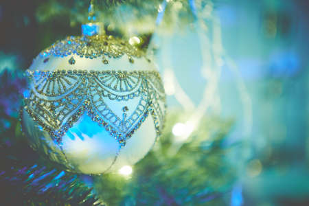 Colorful christmas ornaments and decorations hanging from christmas tree