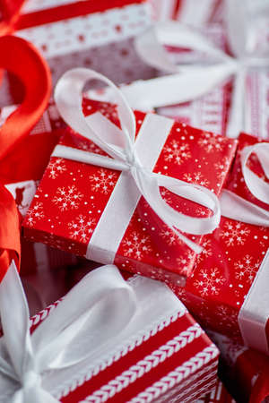 Christmas concept. Close up on festive paper wrapped gifts with ribbon Zdjęcie Seryjne