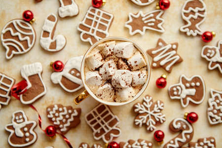 Cup of hot chocolate and Christmas shaped gingerbread cookies