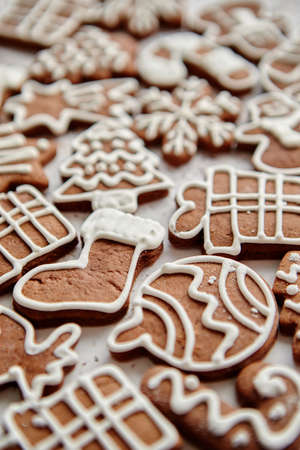 Composition of delicious gingerbread cookies shaped in various Christmas symbols