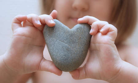 Childs hands hold heart photo