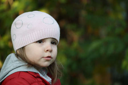Little Girls Portrait In The Autumn Garden photo