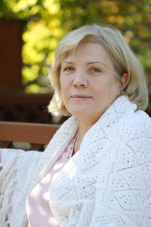 middle age woman:  Portrait in an arbour