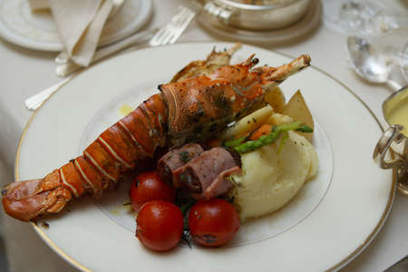 lobster dinner: Beautifully plated gourmet lobster dinner on the table Stock Photo