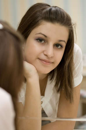 reverberate: Portrait of the young girl. Reflection in the mirror Stock Photo