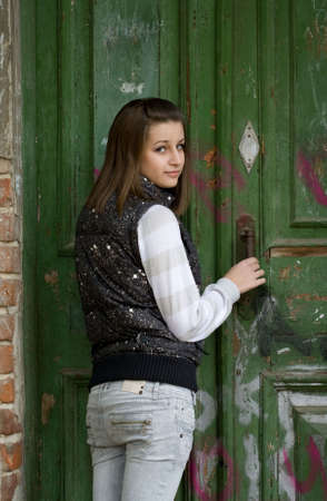 Portrait of the young girl near the old door photo