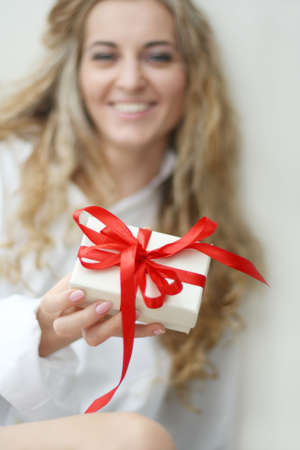 The girl with the present Stock Photo - 5990299