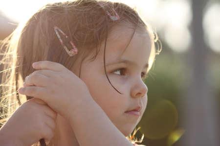 melancholic: Little girl making her wet hair in the sunshine Stock Photo