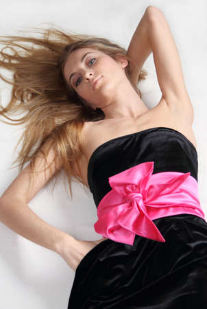 Beautiful blonde girl in black dress with pink bow Stock Photo - 6504047