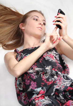 Beautiful blonde girl making a call on mobile phone Stock Photo - 6534074